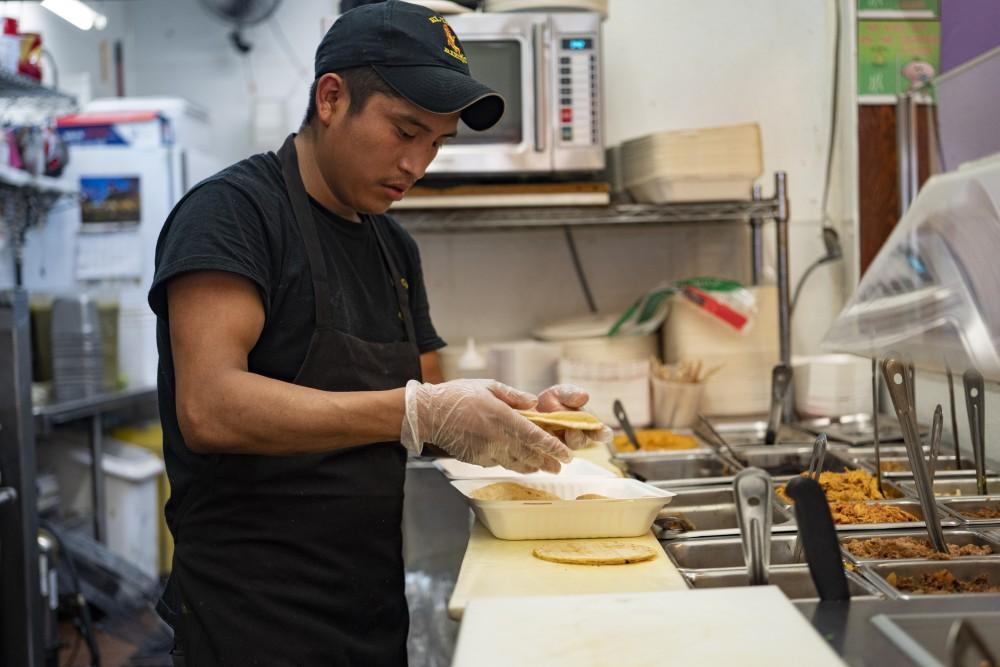 Jose Gonzalez prepares tacos at El Taco Riendo on Central Avenue in Minneapolis on Friday, July 19.
