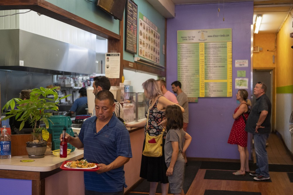 Customers line up for the late afternoon rush at El Taco Riendo on Central Avenue in Minneapolis on Friday, July 19.