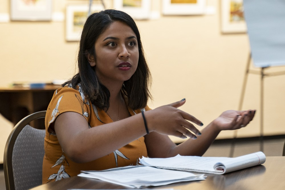 <p>Aurin Chowdhury discusses renters' rights at a Marcy Holmes renters' rights meeting at the First Congregational Church of Minnesota on Thursday, July 25. </p>
