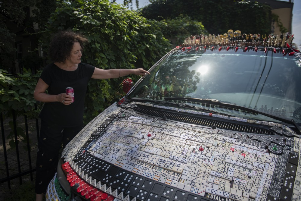 Tjody DeVaal talks about the pieces on her art car on Thursday, July 25 in Minneapolis.