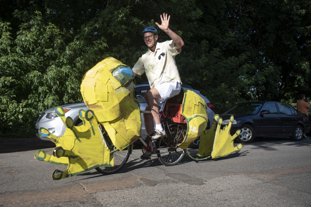 A bike made into a frog is seen in the ArtCar and ArtBike Parade n Saturday, July 27 at Lake Harriet in Minneapolis.