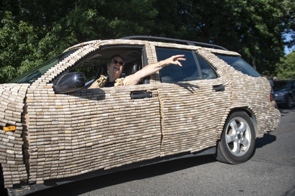 Jan Elftmann, who started the ArtCar Parade in Minneapolis, drives her cork car on Saturday, July 27 at Lake Harriet in Minneapolis.