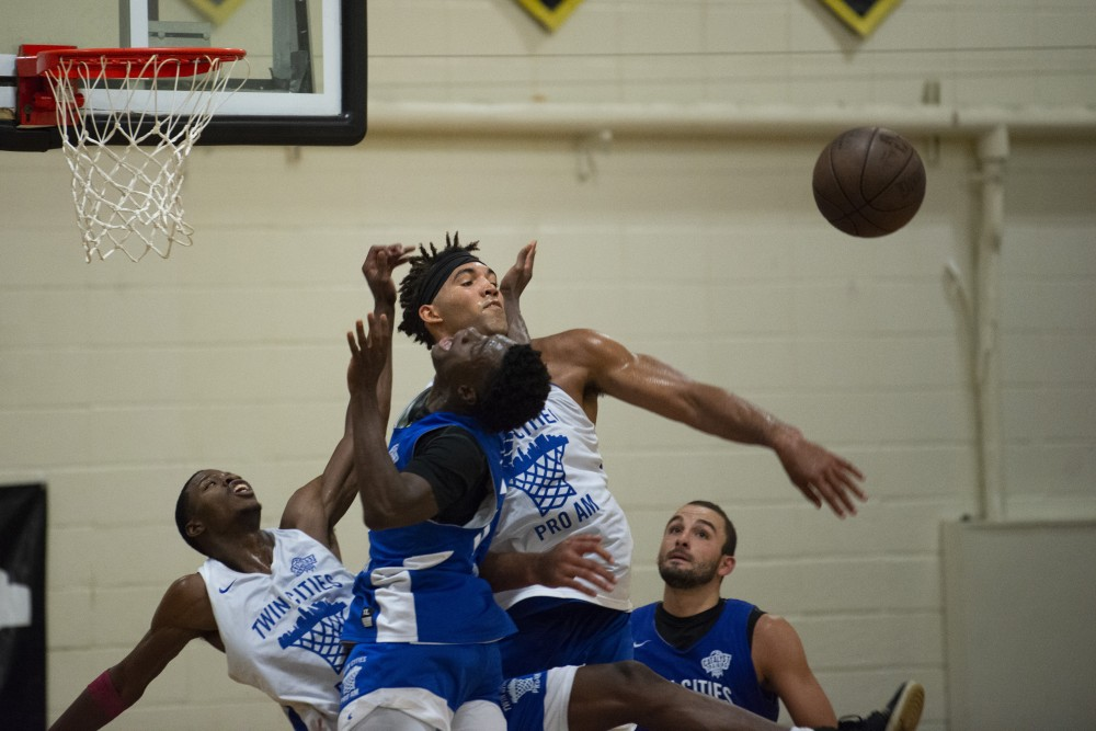 Former Gopher Reggie Lynch swats the ball at DeLaSalle High School in Minneapolis on Thursday, July 25 for the Twin Cities Pro Am basketball league.