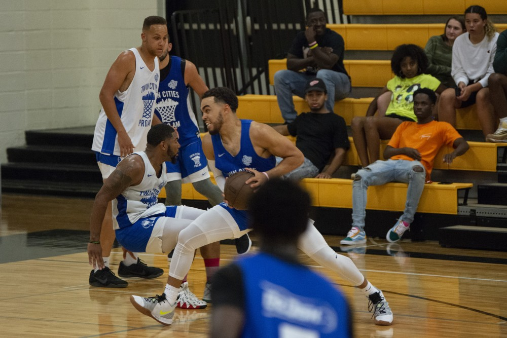 Timberwolve's Tyus Jones runs to the basket at DeLaSalle High School in Minneapolis on Thursday, July 25 for the Twin Cities Pro Am basketball league.