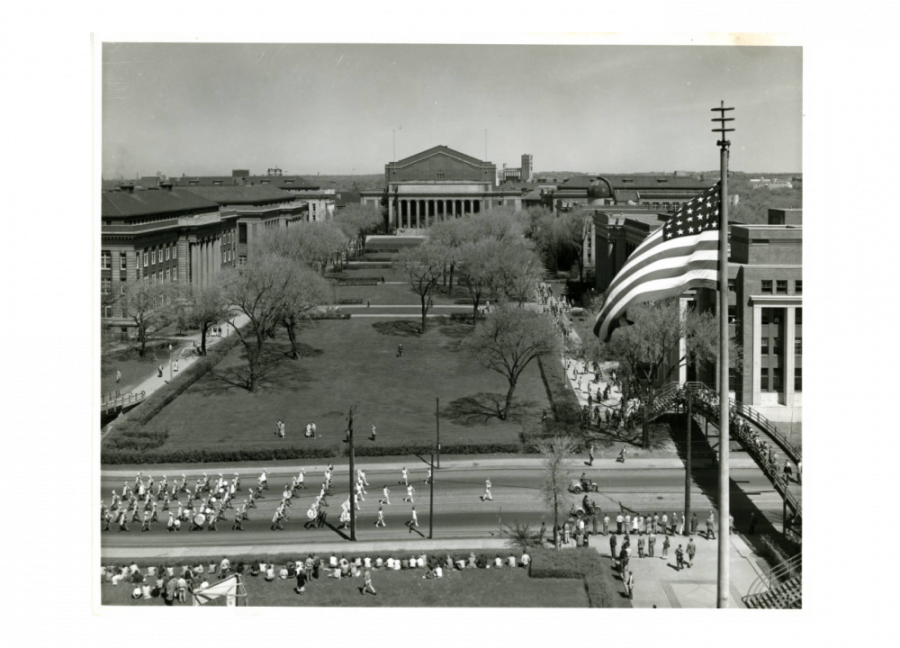 University of Minnesota Marching Band marching on Washington Avenue with Northrop Mall in the background