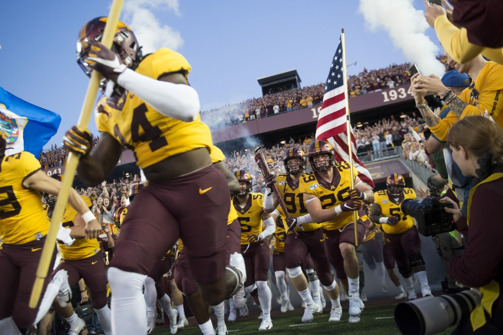 The Gophers run on to the field at TCF Bank Stadium on Thursday, Aug. 29. Minnesota defeated South Dakota State 28-21.