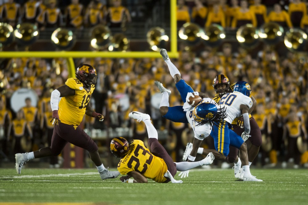 Defensive back Jordan Howden makes a tackle at TCF Bank Stadium on Thursday, Aug. 29, 2019. Minnesota defeated South Dakota State 28-21.