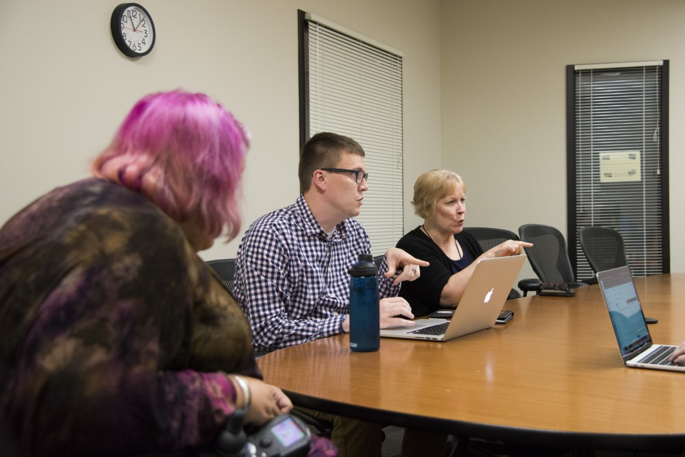 <p>Corbett Laubignat, left, Chris Luhmann and Barb Podesta at a Disabled Employees at the U meeting on Tuesday, Sept. 3. The group aims to build an inclusive and accessible community led by and for disabled University employees. </p>