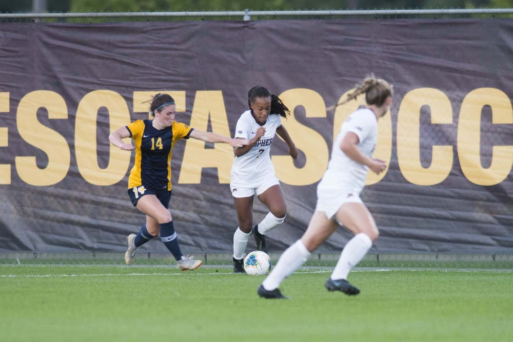 Forward Patricia Ward fights for the ball at Elizabeth Lyle Robbie Stadium on Thursday, Sept. 5. The Gophers lost to Marquette 1-0.