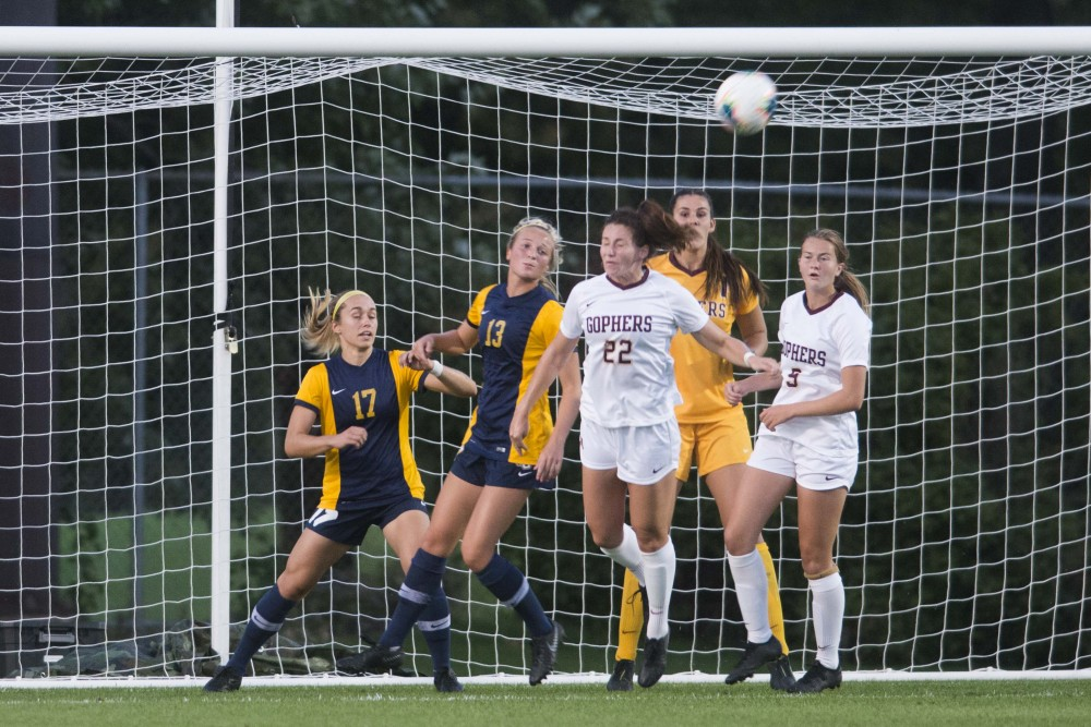 Defender Alana Dressely heads the ball at Elizabeth Lyle Robbie Stadium on Thursday, Sept. 5. The Gophers lost to Marquette 1-0.