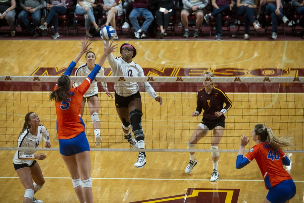 Middle Blocker Taylor Morgan jumps to spike the ball at the Maturi Pavilion on Saturday, Sept. 7. The Gophers defeated Florida 3 sets to 0 for their home opener.