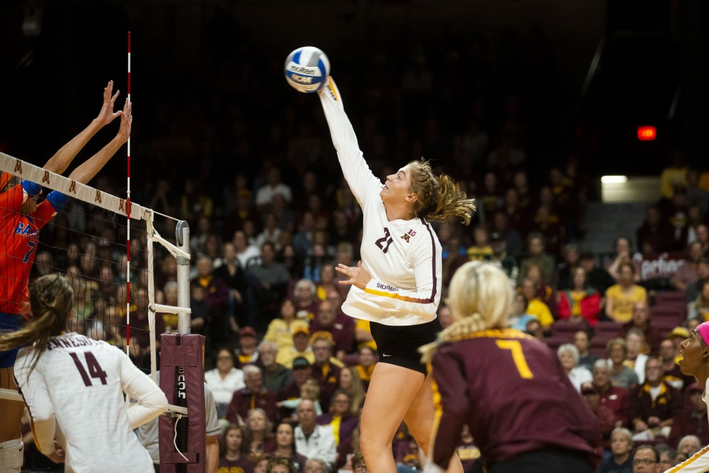 Middle Blocker Regan Pittman spikes the ball at the Maturi Pavilion on Saturday, Sept. 7. The Gophers defeated Florida 3 sets to 0 for their home opener.