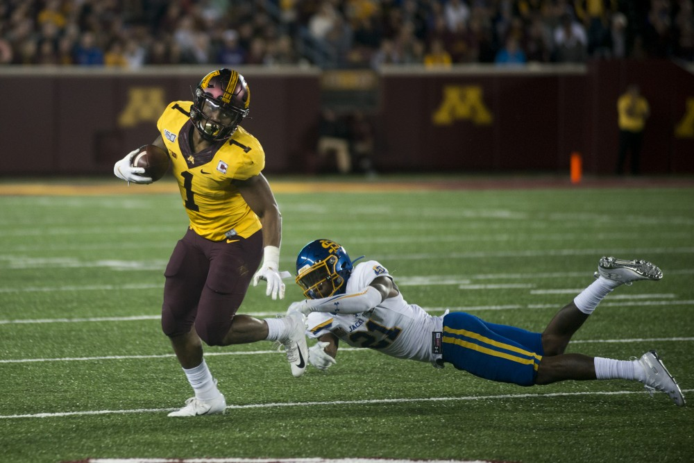 Running back Rodney Smith carries the ball at TCF Bank Stadium on Thursday, Aug. 29. Minnesota defeated South Dakota State 28-21.