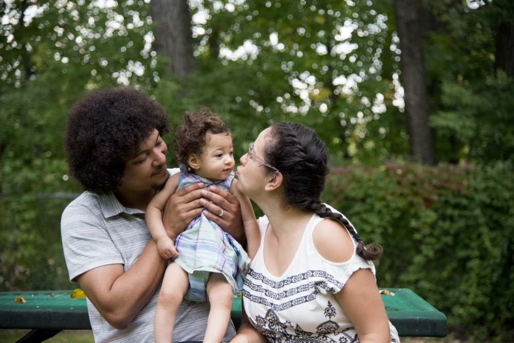 Dr. Dimitri Perusse, left, and his wife, Yari Cabezas-Perusse, play with their daughter, Denali, in their backyard on Tuesday, Sept. 17. Perusse's daughter suffered a stroke right after birth which motivates him in his research on treatment for neurodegenerative diseases.