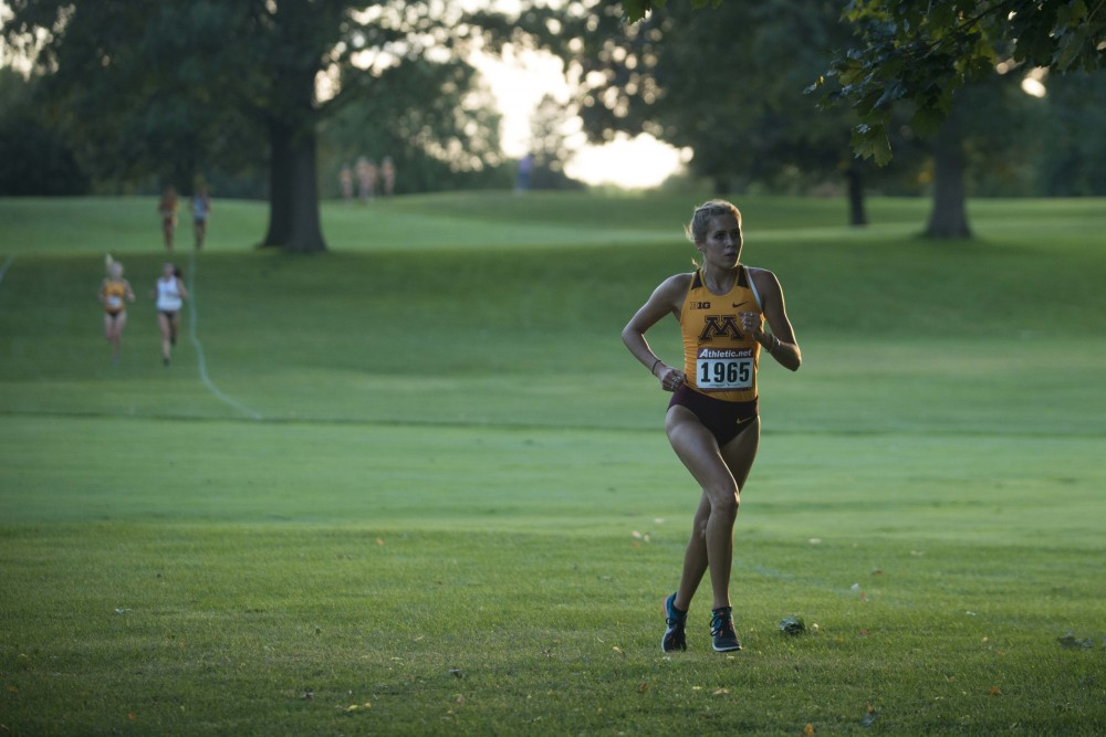 Redshirt Sophomore Anastasia Korzenowski rounds a turn at the Les Bolstad Golf Course during the Oz Memorial on Friday, Sept. 6, 2019. (Kamaan Richards / Minnesota Daily)