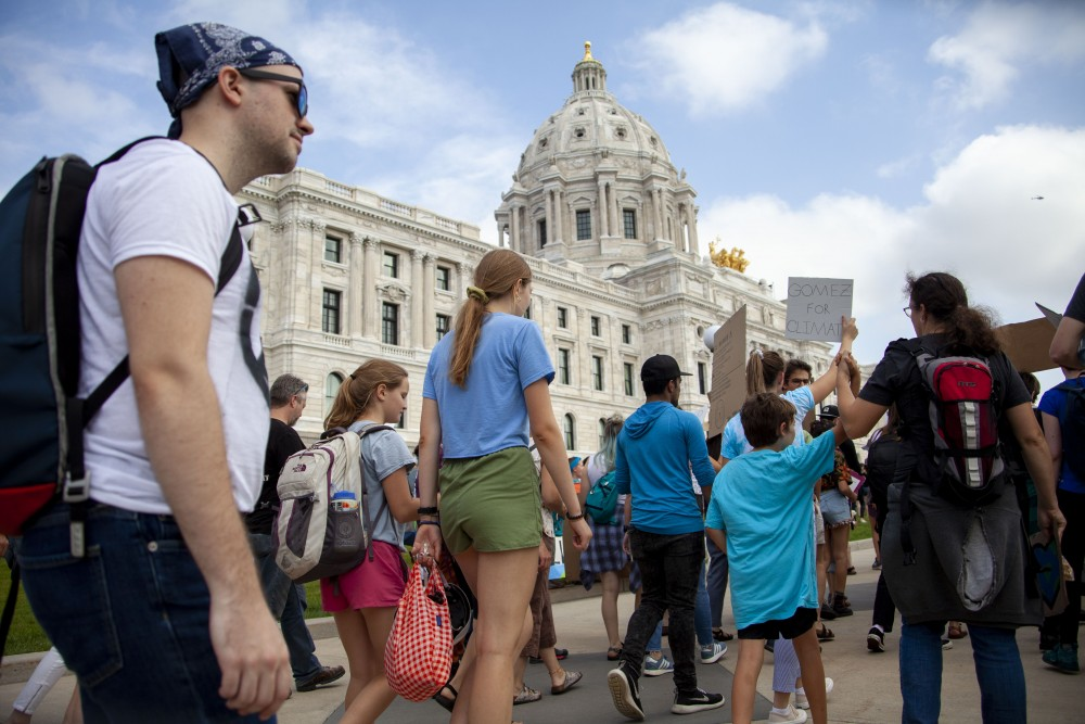 Crowds gather on the lawn in front of the Minnesota State Capitol Building on Friday, Sept. 20, 2019. The Global Climate Strike is a national movement led by youth organizers in protest of current environmental policies.