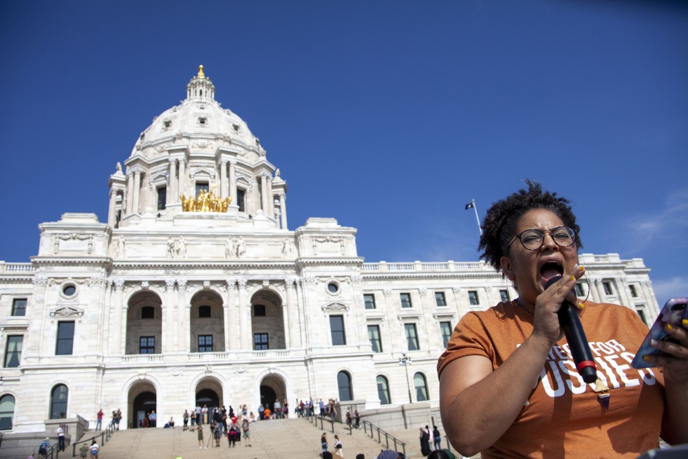 Director of Black Visions Collective Kandace Montgomery delivers a prepared speech to those gathered at the Minnesota State Capitol Building on Friday, Sept. 20, 2019. One of several speakers at the Global Climate Strike, Montgomery advocated for improved environmental legislation and acknowledged the risks climate change poses to marginalized communities. (Kamaan Richards / Minnesota Daily)