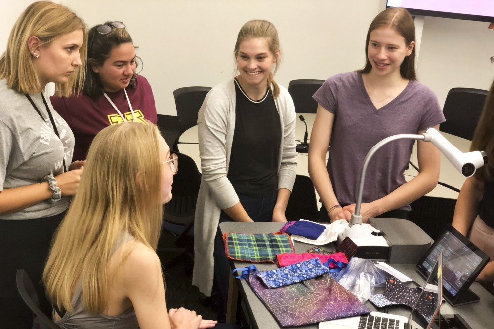 Natalie Paulson speaks with members of Days for Girls about her volunteer work in Haiti in Bruininks Hall on Wednesday, Sept. 18, 2019. Days for Girls is a non-profit that provides communities in need with supplies for sustainable menstrual care.