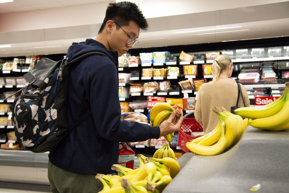 Kaiwei Wu, a Senior studying Computer Science, shops for groceries at Target in Dinkytown on Monday, Sept. 23, 2019. Due to currency exchange rates, living expenses and tuition fees have increased for Chinese students.