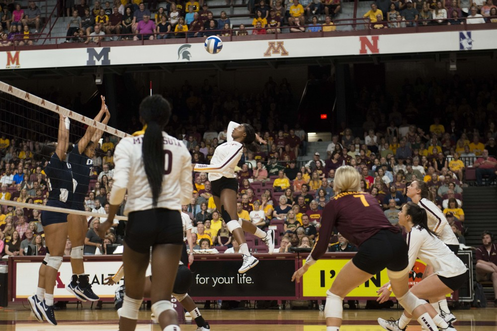 Gophers Junior Stephanie Samedy leaps to spike the ball at the Maturi Pavilion on Saturday, Sept. 21, 2019.  The gophers defeated Oral Roberts three matches to none.  (Kamaan Richards / Minnesota Daily)