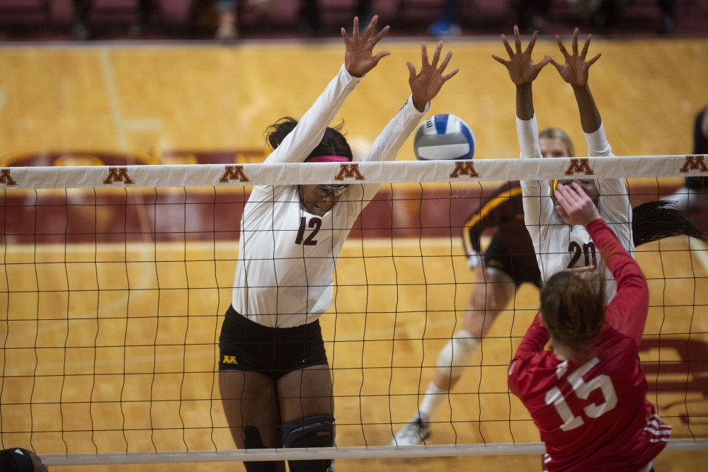 Middle Blocker Taylor Morgan defends against a spike at Maturi Paviion on Friday, Sept. 27, 2019. The Gophers went on to defeat Indiana three matches to none.