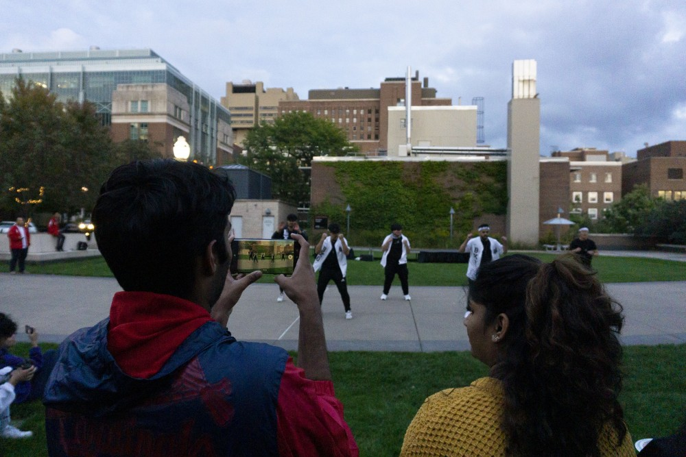 Students gather to watch fraternity Beta Chi Theta dance at the