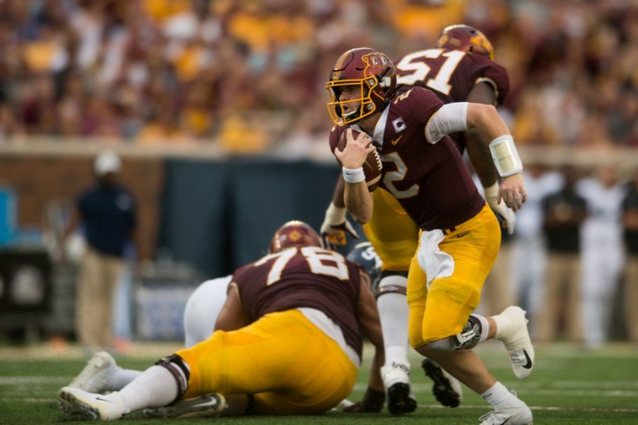 Quarterback Tanner Morgan carries the ball at TCF Bank Stadium on Saturday, Sept. 14.  The Gophers defeated Georgia Southern 35-32.