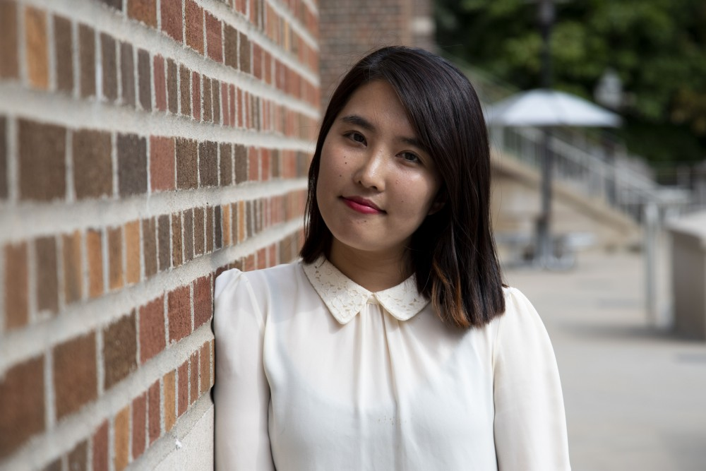 "Hanna Sun, a student in the College of Education and Human Development, poses for a portrait at Coffman Memorial Union on Monday, Sept. 30, 2019. Sun says she lives by the quote, ""Be the change you wish to see!"""