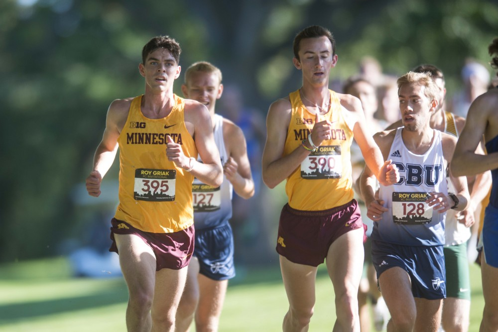 <p>Redshirt Sophomore Dawson Larance and Redshirt Senior Shane Streich approach an intersection during the 2019 Roy Griak Invitational at the Les Bolstad Golf Course on Saturday, Sept. 28, 2019.</p>