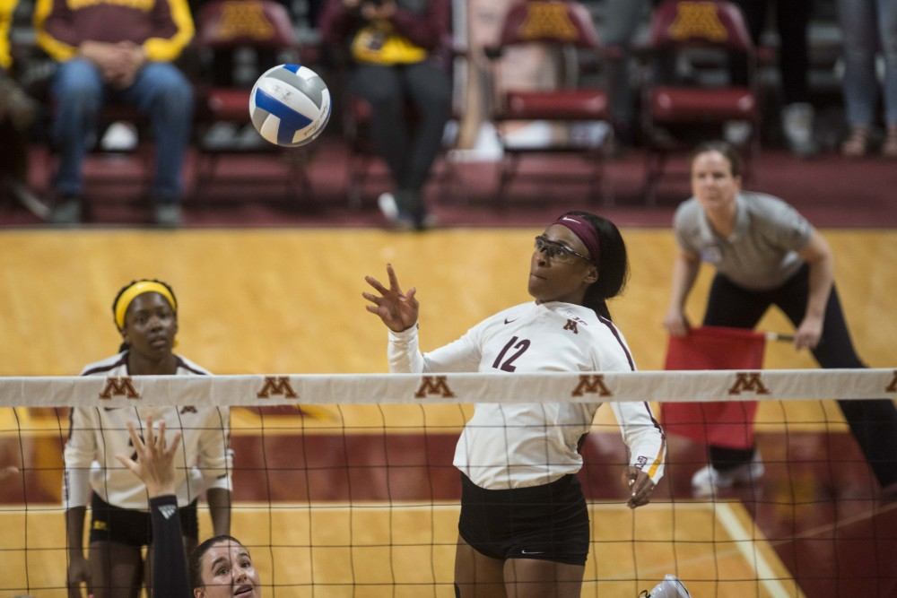 Middle Blocker Taylor Morgan jumps for the ball at the Maturi Pavilion on Saturday, Oct. 5, 2019. The Gophers defeated Rutgers three sets to one.