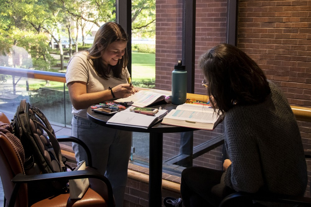 First year students Annika Cushnyr, left, and Tori Seaver, right, study in Mondale Hall on Monday, Oct. 7.