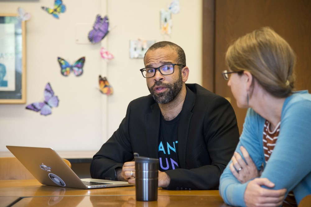 Douglas Kearney, an assistant professor in the Department of English, fields questions from his colleagues in Lind Hall on Tuesday, Oct. 8, 2019. The department's Equity, Diversity and Inclusion Committee developed its first-ever report which lays out a plan to improve diversity across curriculum and personnel.
