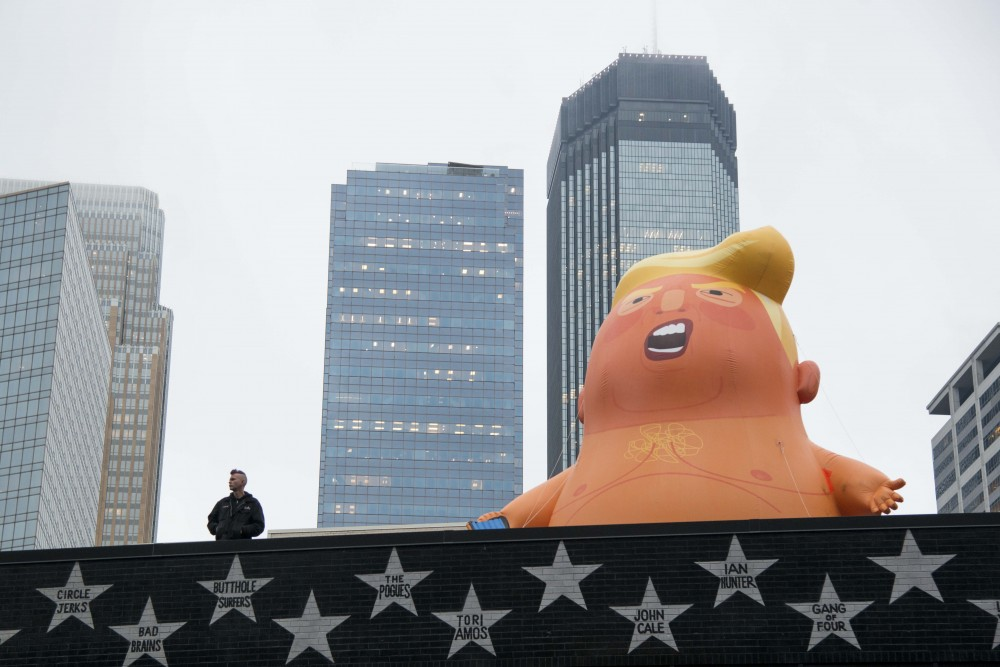 """A """"Trump Baby"""" balloon is seen on the Saloon in downtown Minneapolis outside the Target Center on Thursday, Oct. 10."""