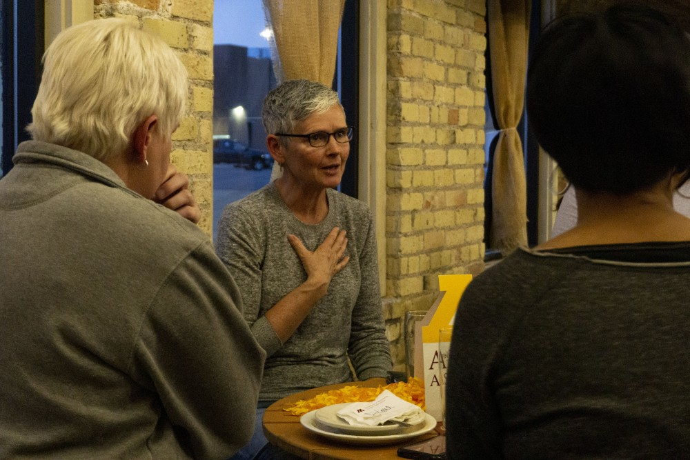 Cathy Berlin, a University of Minnesota alumna, talks to other University alumni at the Urban Growler Brewing Company for the Pride Alumni Network Launch on Friday, Oct. 11.