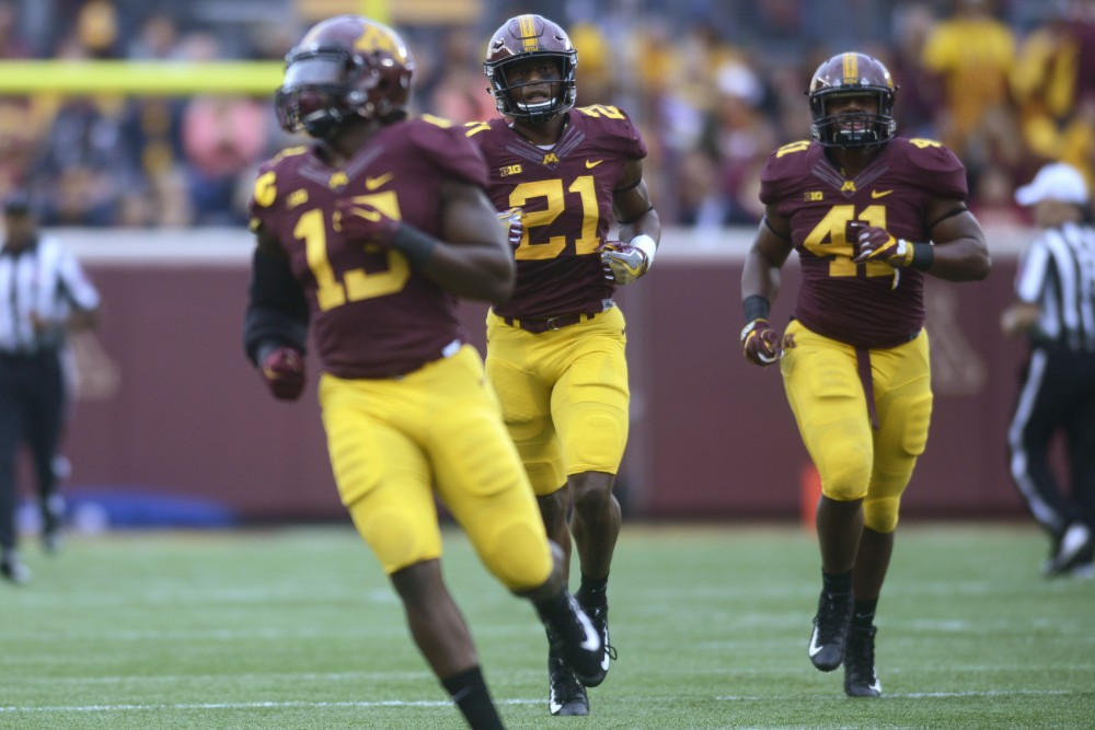 Linebackers Jonathan Celestin, Kamal Martin and Thomas Barber run into formation on Saturday, Oct. 21, 2017 at TCF Bank Stadium. The Gophers defeated Illinois 24-17 during the homecoming game.