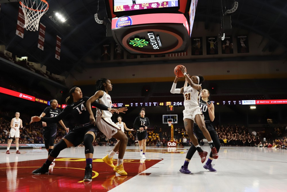 Jasmine Brunson jumps to shoot the ball during the game against Northwestern on Sunday, Feb. 10 at Williams Arena.