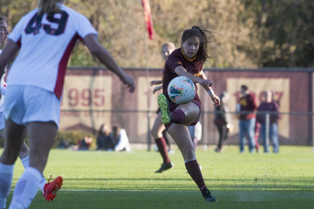Midfielder Katie Duong launches a pass at Elizabeth Lyle Robbie Stadium on Thursday, Oct. 17. The Gophers went on to tie Nebraska 1-1.