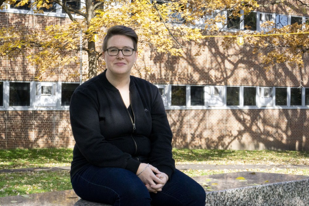 Sarah Vast, Human Resources Assistant for the University of Minnesota, poses for a portrait outside Peik Hall on Wednesday, Oct. 23. Last winter Vast struggled to find child care when schools closed due to extreme cold weather and ended up bringing their child to work at times. Other parents also coordinated when they had difficulty finding child care on short notice.