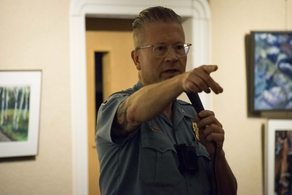 Minneapolis Police Officer Todd Loining addresses concerns regarding safety in the Marcy-Holmes neighborhood at the First Congregational Church on Tuesday, Oct. 22.