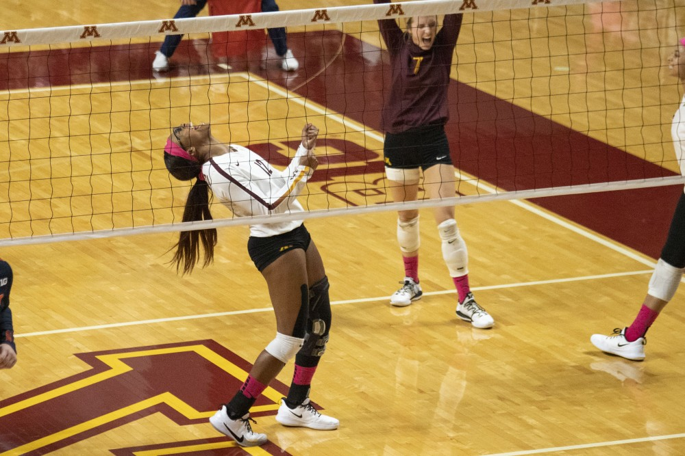 Middle Blocker Taylor Morgan celebrates a scored point at the Maturi Pavilion on Saturday, Oct. 19. The Gophers defeated Illinois three sets to one.