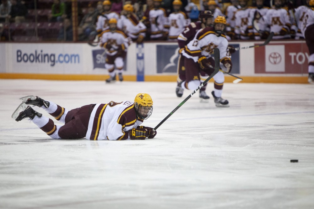Forward Sammy Walker falls to the ice at the 3M Arena at Mariucci on Friday, Oct. 25. The Gophers went on to lose 2-5 to the University of Minnesota Duluth.