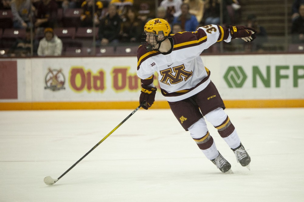 Forward Ben Meyers follows the puck across the rink at the 3M Arena at Mariucci on Friday, Oct. 25. The Gophers went on to lose 2-5 to the University of Minnesota Duluth.