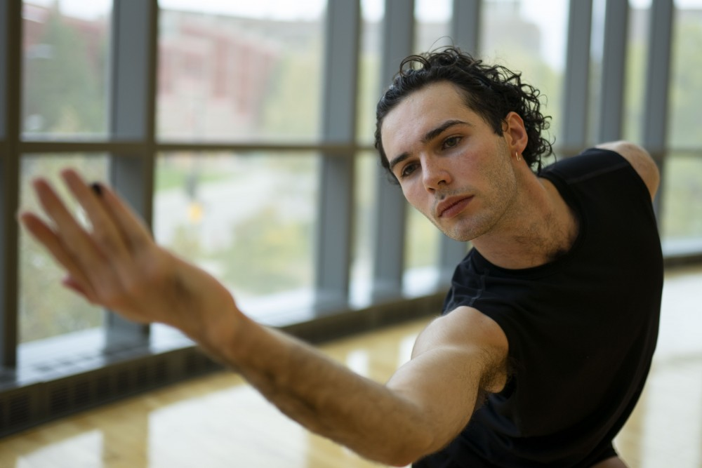 Connor Simone, a part-time student and full-time trainee at TU Dance, performs at the University Recreation and Wellness Center on Sunday, Oct. 27.