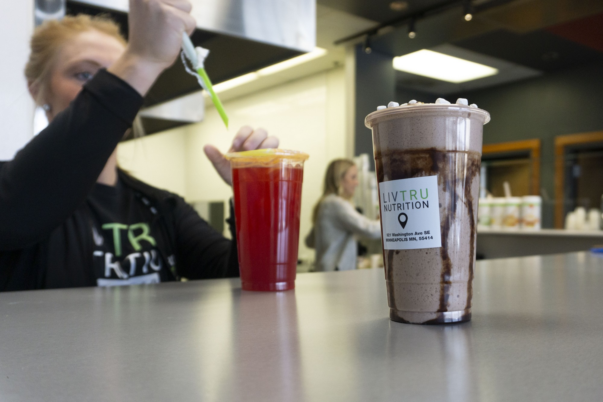 Olivia Wolbert, owner of the newly opened Liv Tru Nutrition, serves tea to a customer on Wednesday, Oct 30.
