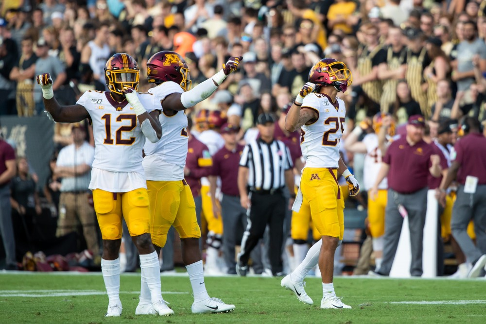 Defensive back Benjamin St-Juste, right, raises his arm with his teammates at Ross-Ade Stadium on Saturday, Sept. 28. (Courtesy of Brad Rempel / Gopher Sports)