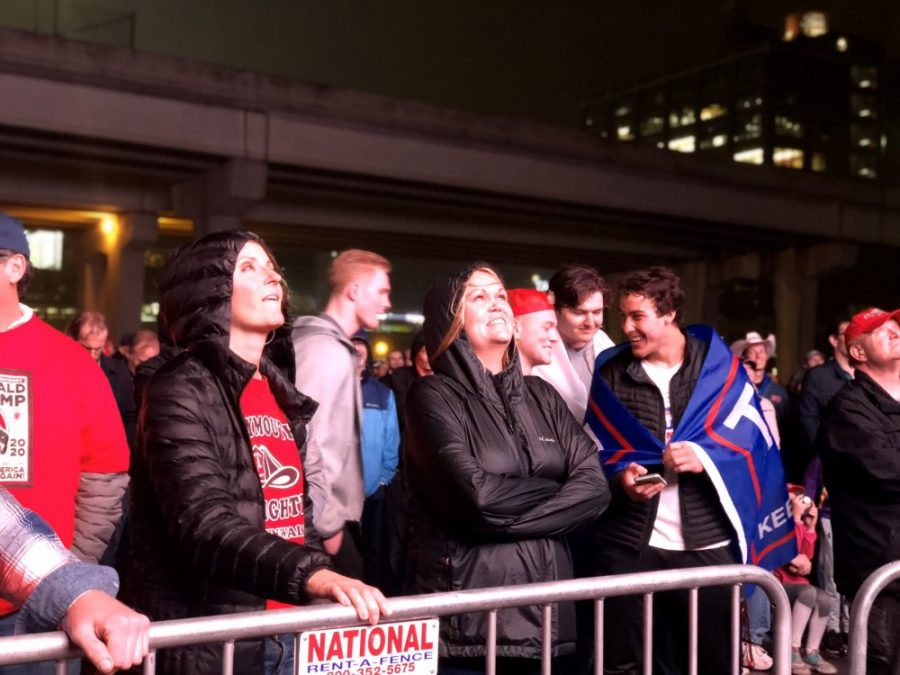 Attendees of the Trump rally in Minneapolis watch a live broadcast of Trump's speech outside Target Center on Thursday, Oct. 10.