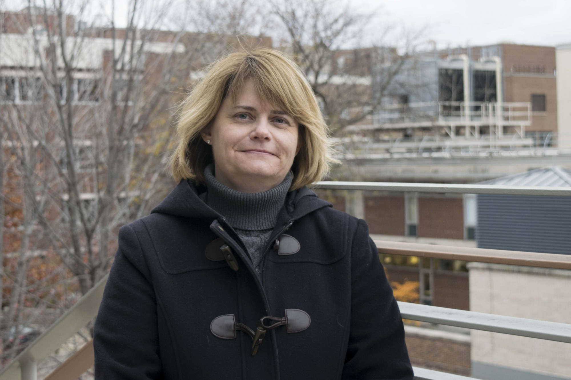 Faculty Consultative Committee Chair Amy Pittenger poses for a portrait outside of Coffman Union on Friday, Nov. 2.