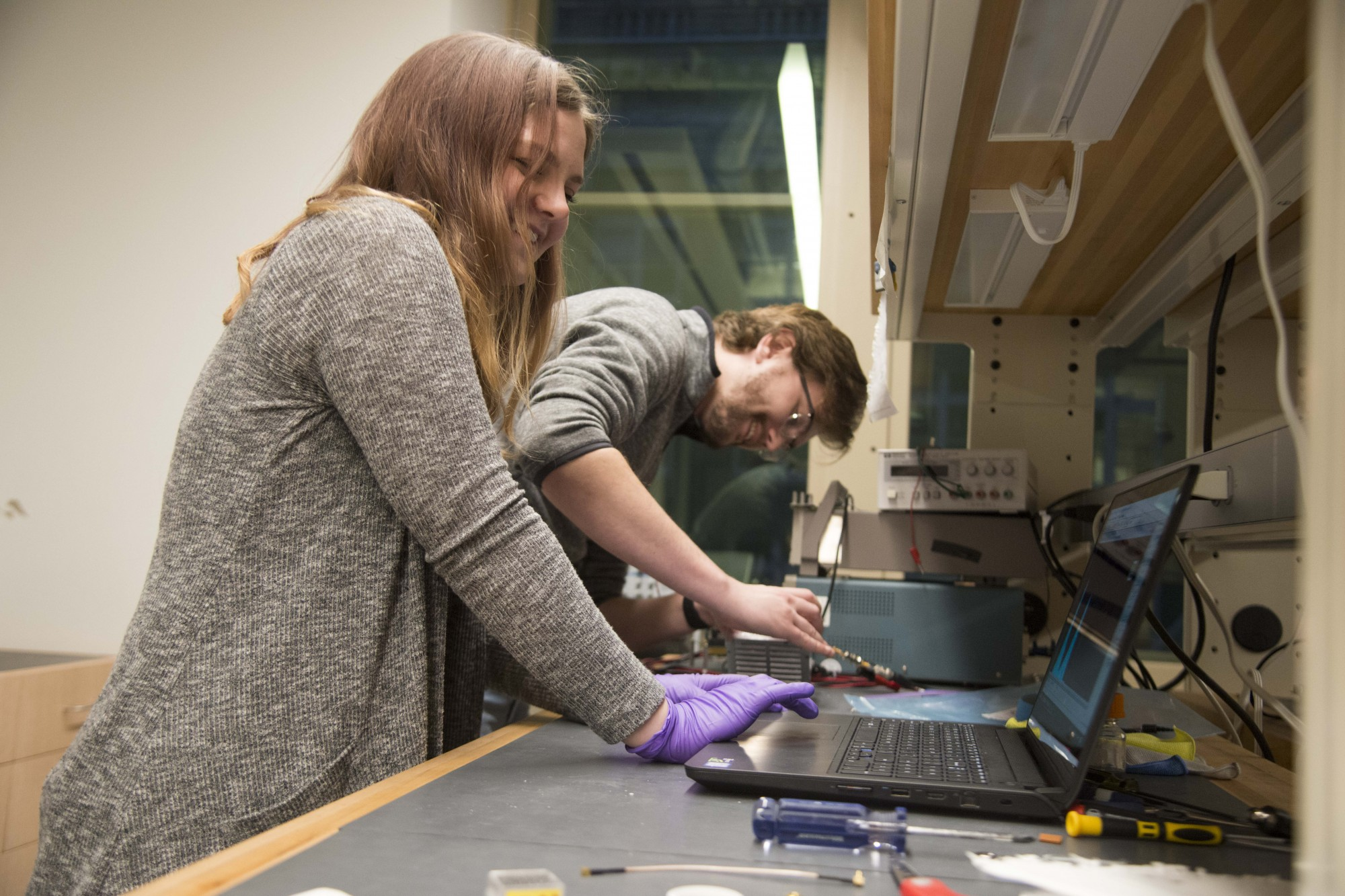 Project manager Jenna Burgett, left, and chief engineer Kyle Houser, right, discuss their process of creating and designing SOCRATES in a lab in Tate Hall on Friday, Nov. 8. SOCRATES, which NASA launched into space on Saturday, Nov. 2, is expected to begin orbiting the earth in January of 2020.