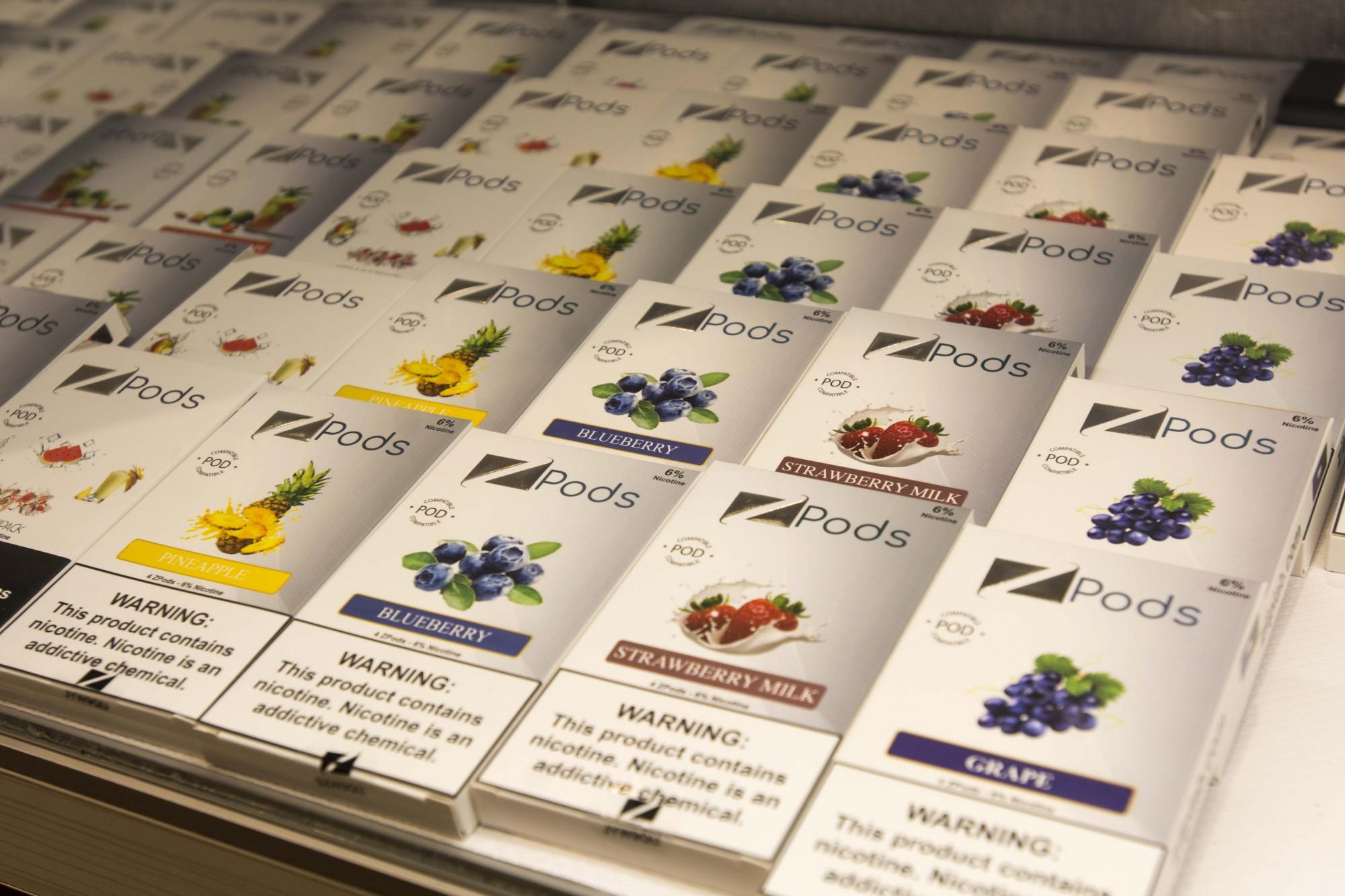 Flavored vape pods seen on display in Hideaway in Dinkytown on Friday, Nov. 8.