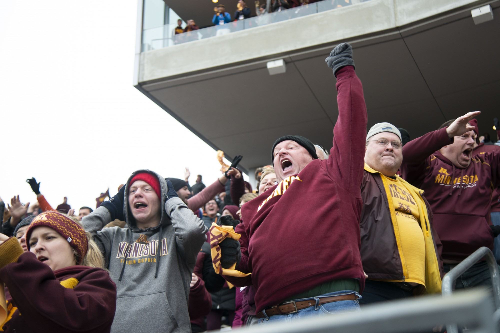 Fans cheer for the Gophers during the game against Penn State at TCF Bank Stadium Saturday, Nov. 9. The Gophers won 31-26 bringing their record to 9-0. A first since 1904.